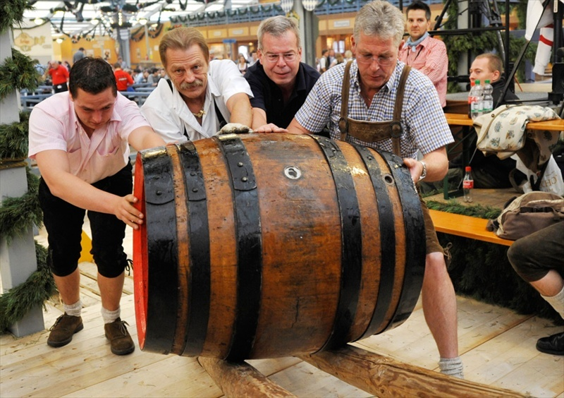 Oktoberfest-in-Munich-Workers-move-the-first-beer-barrel-for-the-opening-day-of-the-176th-Oktoberfest-in-Munich-Germany